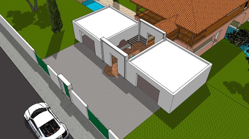 Les garages encadrant le patio