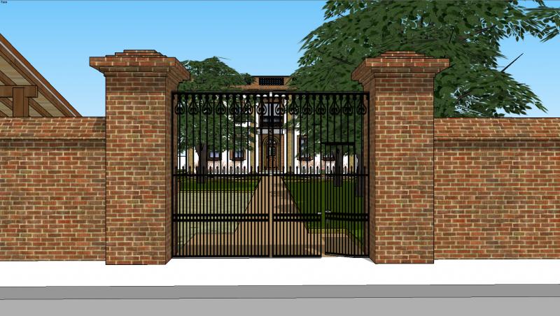 En entrant dans la propriété , les piliers et la grille